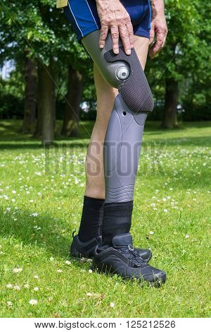 Side View On False Leg Of Man Walking On Grass