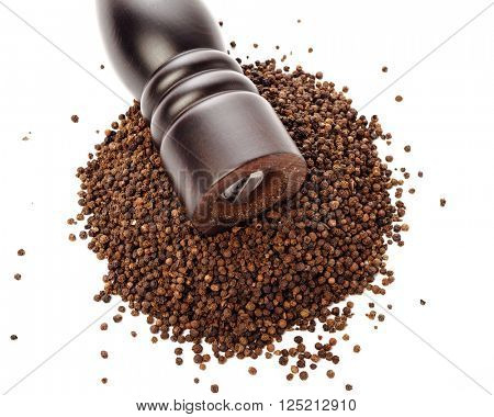 pepper mill on peppercorns heap, isolated on white