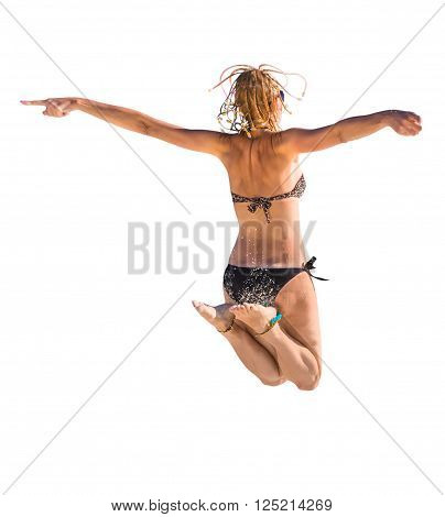 Back of happy and attractive woman with black bikini jumping in the air. Isolated on white background.