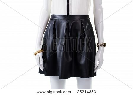 Mannequin wearing skirt and accessories. Female leather garment with watch. Fashionable skirt of dark color. Girl's attractive stylish look.
