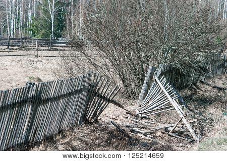 Rickety broken fence of  gray moth wood.