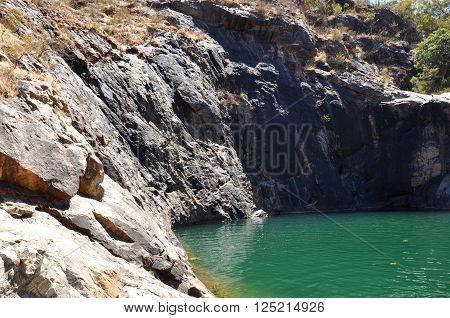 Natural granite rock cliffs at Serpentine Falls with green rock pools in Serpentine, Western Australia.