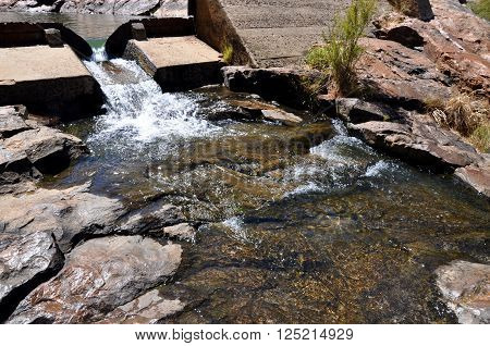 Small dam at Serpentine Falls with granite rock and natural rock pools in Serpentine, Western Australia.
