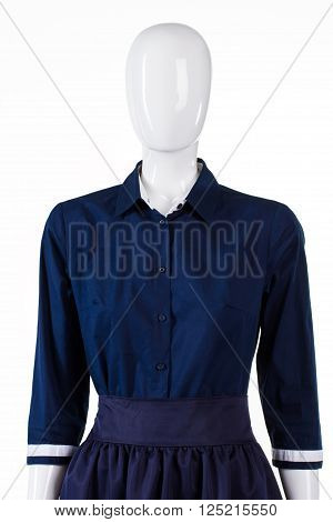 Half sleeve shirt on mannequin. Girl's shirt with short sleeves. Navy casual evening shirt. New merchandise in outlet shop.