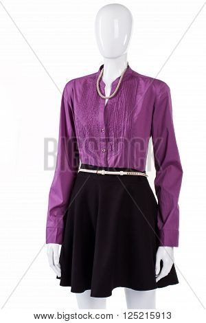 Dark skirt with purple shirt. Purple shirt on female mannequin. Trendy shirt with stand collar. New fashionable long sleeve shirt.