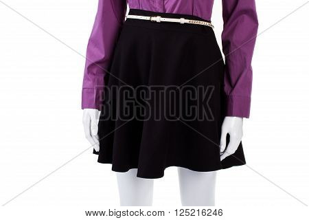 Black skirt with white belt. Female mannequin wearing thin belt. Tiny leather belt on showcase. Part of woman's trendy look.
