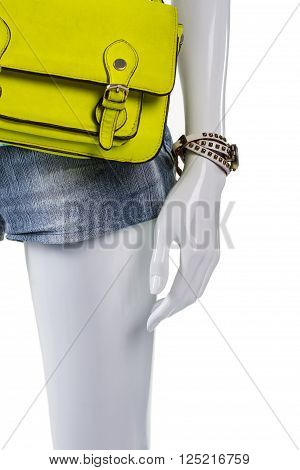 Classic watch and lime purse. Mannequin with bag and watch. Woman's stylish handy accessories. Bright color of upcoming season.