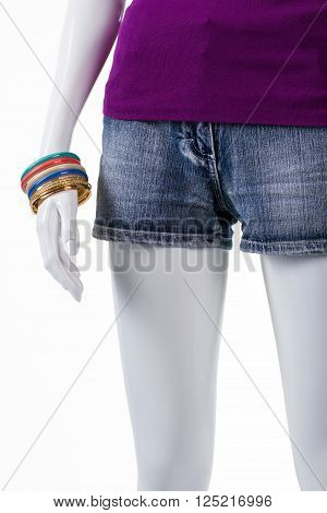 Short shorts and bracelet set. Mannequin wearing colorful bracelet set. Lady's summer shorts in stock. Simple patterns and warm colors.