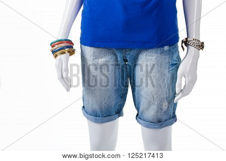 Woman's long light denim shorts. Long denim shorts on mannequin. High-quality shorts and accessories. Summer shorts from new collection.