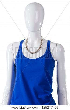 Blue top and simple necklace. Female mannequin wearing bijouterie necklace. Young woman's plain accessory. Inexpensive necklace on display.