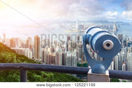 touristic telescope with cityscape and skyline of portland at sunrise