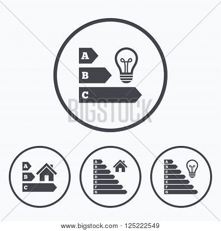 Energy efficiency icons. Lamp bulb and house building sign symbols. Icons in circles.