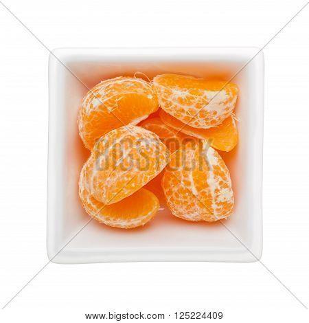 Peeled mandarin orange in a square bowl isolated on white background