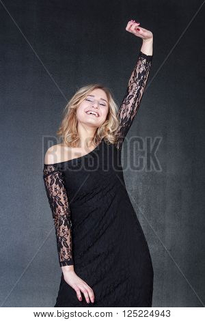 nice and young blonde in a black dress