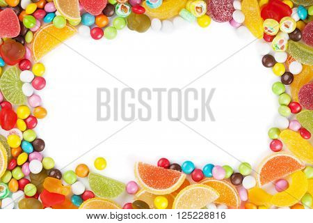 Colorful candies, jelly and marmalade frame. Isolated on white background. Top view with copy space
