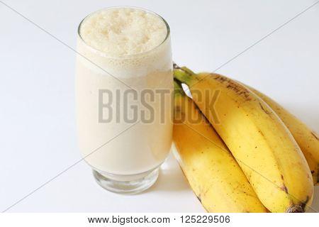 Banana Lassi, famous nepali yogurt drink on white isolated background