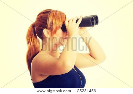 Overweight woman seeking with binocular