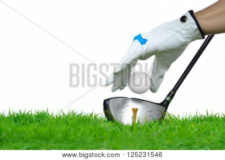 Golfer's hand holding golf ball with driver on green grass isolated on white background
