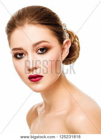 Portrait of the beautiful young girl with red lips and evening makeup.