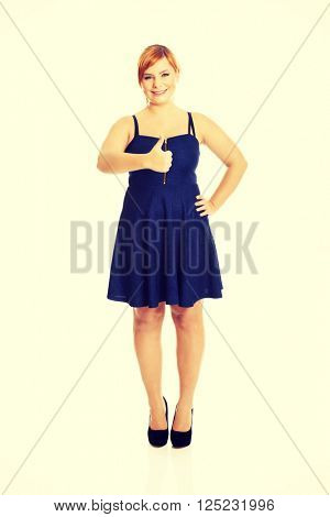 Happy overweight woman with thumbs up