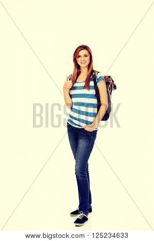 Teenage smile woman with backpack