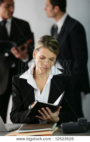 Businesswoman looking at her agenda