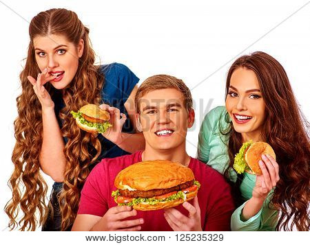 Group people eating tasty hamburgers .Girls fed burger man. Fast food concept with two women and one man . Isolated.