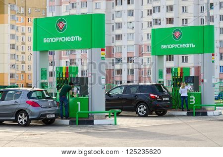 GOMEL BELARUS - APRIL10 2016: Unidentified people are spending a payment of fuel on automatic filling station on Street Checherskaya Gomel Belarus