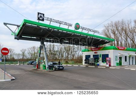 GOMEL BELARUS - APRIL 10 2016: Unidentified man carries fueling of car at the filling station