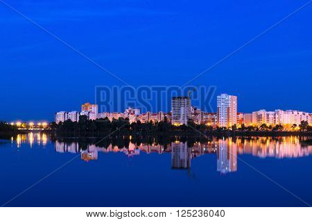 Beautiful view of evening Gomel with reflection in the lake