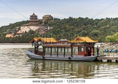 Beijing China - October 14 2013: Old traditional ferry boat in the lake at Summer Palace in Beijing China.