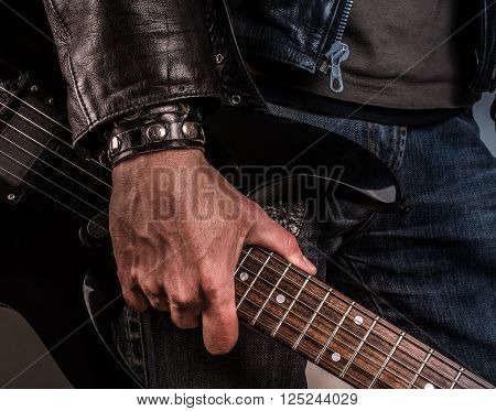Rock star with an old scratched guitar