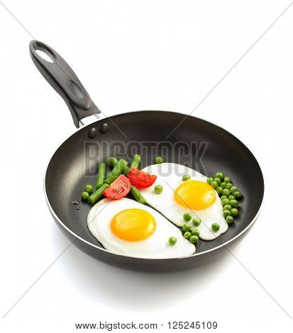 fried egg in frying pan isolated on white background