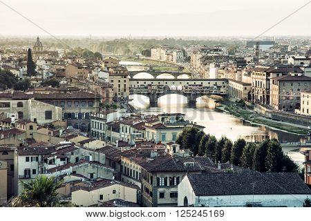 Florence city with amazing bridge Ponte Vecchio,Tuscany, Italy. Sunset photo. Travel destination. Cradle of the renaissance.