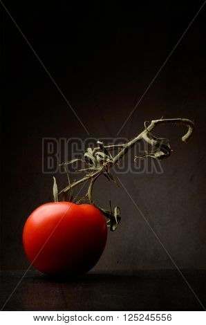 Close up shot of a Tomato on a dark background