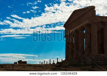 Greek Temple surrounded by a blue sky in Agrigento, Sicily Italy