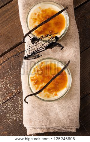 creme brulee ( cream caramel ) on wooden tabletop view