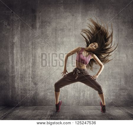 Fitness Sport Dance Woman Dancer Flying Hair Dancing over Concrete background