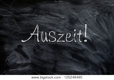 Blackboard with the German word Auszeit Time out concept