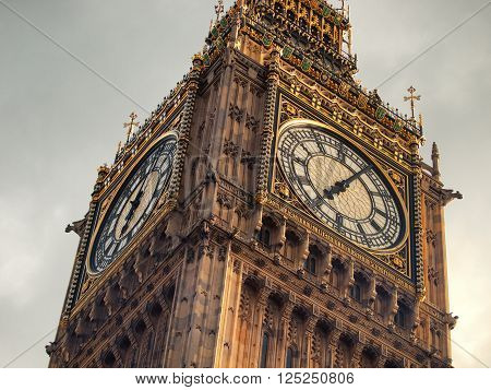 Close up of Big Ben clock tower in London on a dark cloudy day