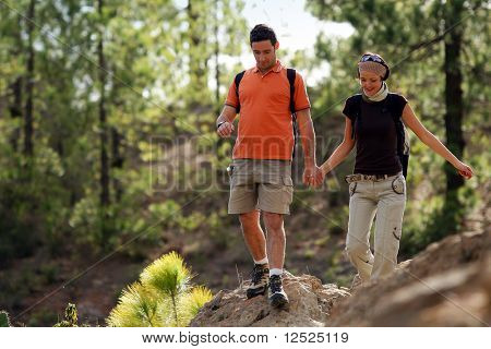Couple rambling in a forest