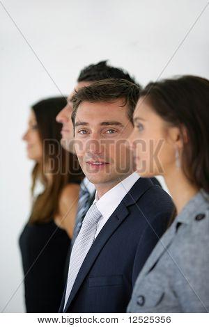 Portrait of businessman with wor kteam