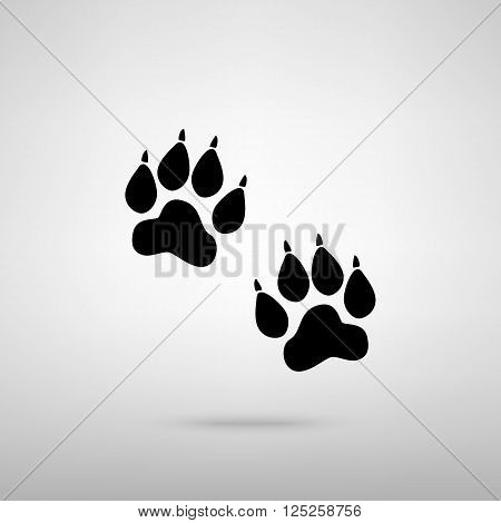 Animal Tracks sign. Black with shadow on gray.
