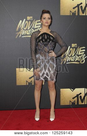 LOS ANGELES - APR 9:  Katie Stevens at the 2016 MTV Movie Awards Arrivals at the Warner Brothers Studio on April 9, 2016 in Burbank, CA