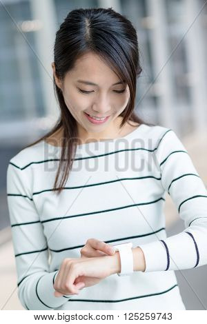 Young woman use of smart watch