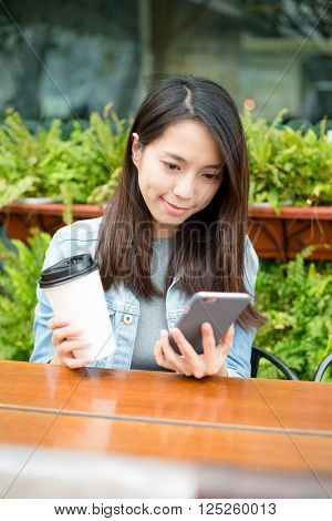 Woman having coffe at outdoor coffee shop