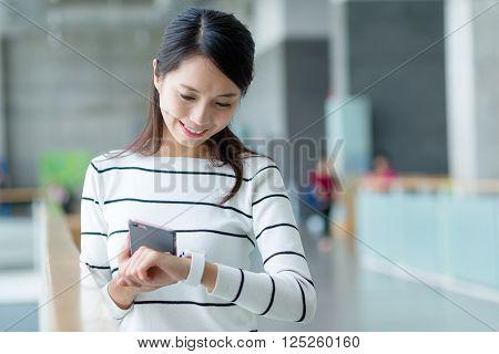 Woman connect cellphone and smart watch