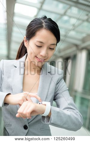 Business woman use of smart watch