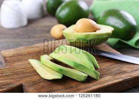 Fresh sliced avocado on cutting board, close up