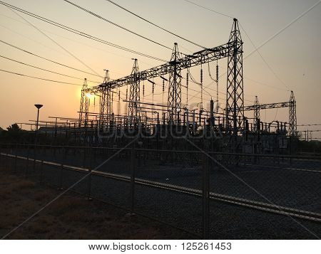 Electricity power plant with sunset / Electricity pylons at sunset